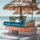 Books sunglasses at the beach