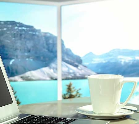 Business Traveler looking at lake view with coffee
