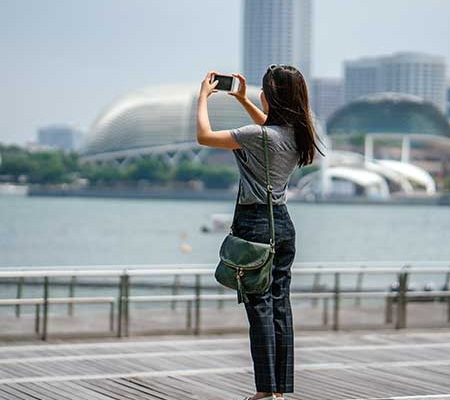 Girl taking a photo of city