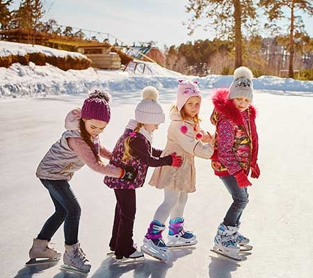 Girls Ice Skating on a pond